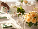 yellow and green table setting with roses